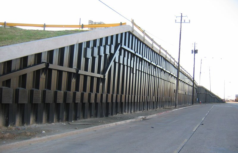 Tiebacks for retaining walls are similar to tiedowns which provide vertical support to a foundation.